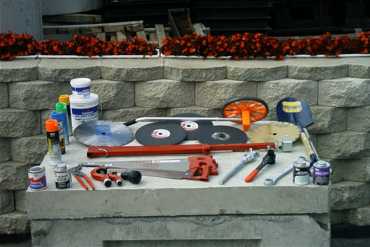 Abrasive Cutting Wheels|Copper Tubing Cutters|Diamond Tip Cutting Wheels|Hammer Flares|Hydrant Wrenches|Pipe Compound (Lube)|Tapping Compound|Water Main Wrenches|Pliers|PVC Cement|PVC Saws|Shovels|Ready-Measure Measuring Wheels|Upside-Down Marking Paint